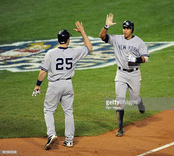 Alex Rodriguez of the New York Yankees highfives Mark Teixeira after his tworun home run in the top of the fourth inning during Game Three of the...