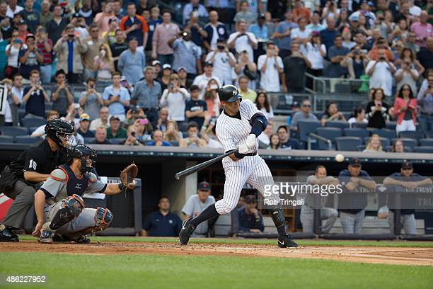 Alex Rodriguez of the New York Yankees hits a home run and gets his 3000th career hit in the first inning against Justin Verlander of the Detroit...