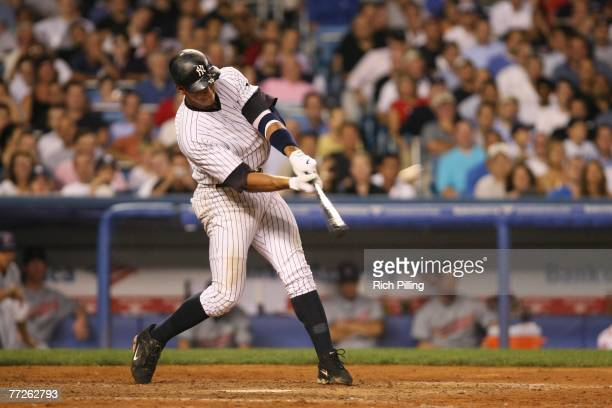 Alex Rodriguez of the New York Yankees hits a home run during the American League Division Series Game 4 against the Cleveland Indians at the Yankee...