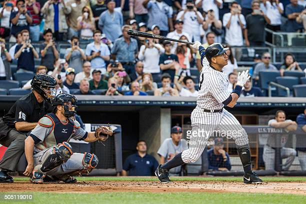 Alex Rodriguez of the New York Yankees hits a home run for his 3000th career hit in the first inning against Justin Verlander of the Detroit Tigers...
