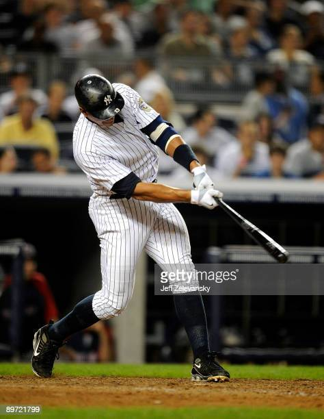 Alex Rodriguez of the New York Yankees hits a home run in the seventh inning against the Boston Red Sox during their game on August 9 2009 at Yankee...