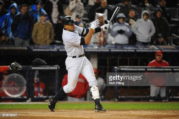 Alex Rodriguez of the New York Yankees hits a home run to tie the game in the eleventh inning of Game Two of the ALCS against the Los Angeles Angels...