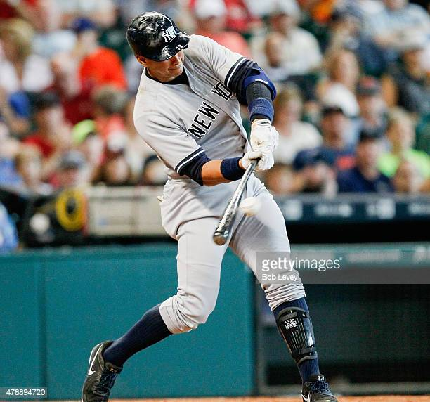 Alex Rodriguez of the New York Yankees hits a line drive to center in the sixth inning against the Houston Astros at Minute Maid Park on June 28 2015...