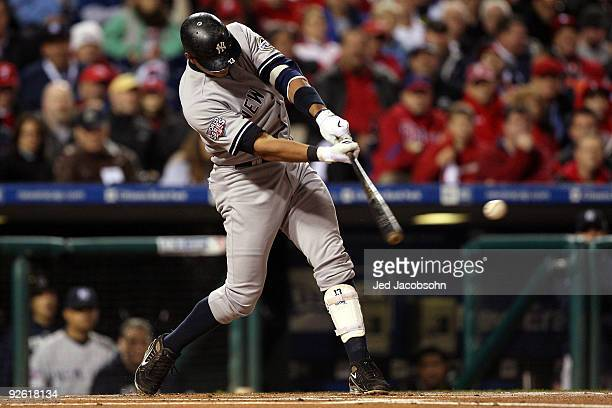 Alex Rodriguez of the New York Yankees hits a RBI double in the top of the first inning against the Philadelphia Phillies in Game Five of the 2009...
