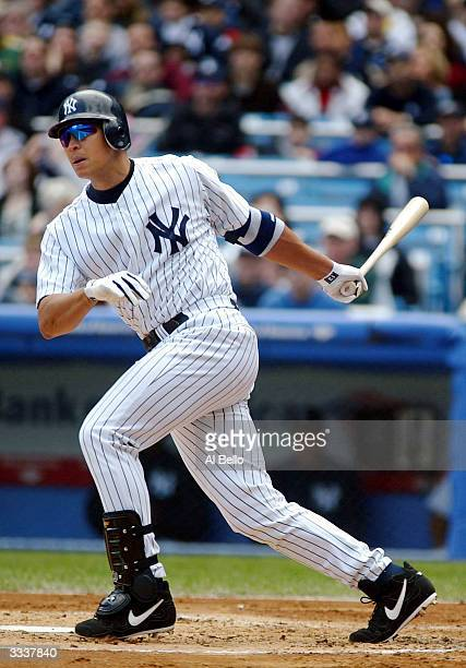 Alex Rodriguez of the New York Yankees hits a single against the Chicago White Sox during their game on April 10 2004 at Yankee Stadium in the Bronx...