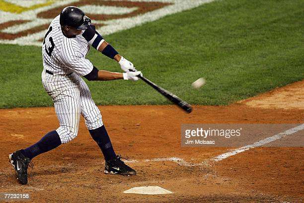 Alex Rodriguez of the New York Yankees hits a solo home run seventh inning against the Cleveland Indians during Game Four of the American League...