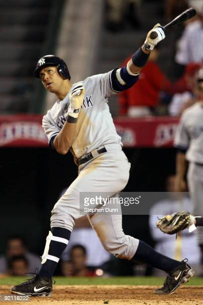 Alex Rodriguez of the New York Yankees hits a two run home run during the fifth inning in Game Four of the ALCS against the Los Angeles Angels of...