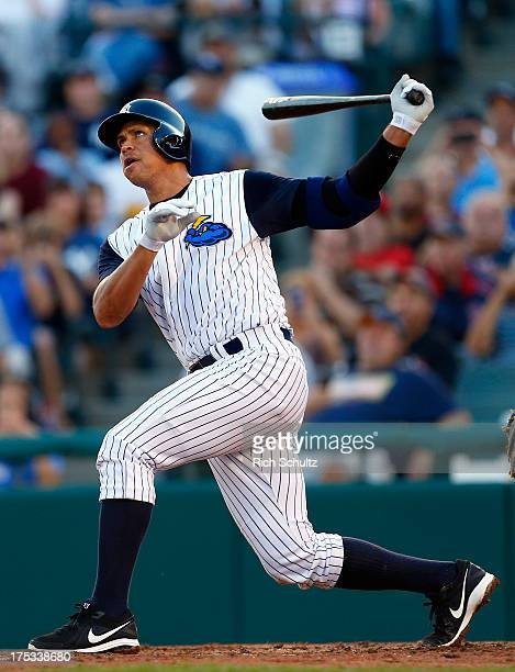 Alex Rodriguez of the New York Yankees hits a tworun home run in the third inning of a rehab game for the Trenton Thunder against the Reading Fightin...
