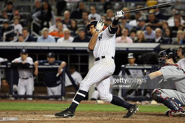 Alex Rodriguez of the New York Yankees hits an RBI single in sixth inning against the Minnesota Twins in Game Two of the ALDS during the 2009 MLB...