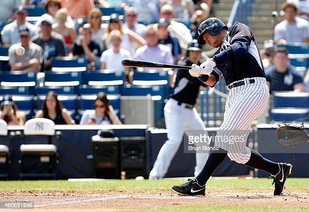 Alex Rodriguez of the New York Yankees hits an RBI single off of pitcher Nathan Karns of the Tampa Bay Rays during the second inning of a spring...