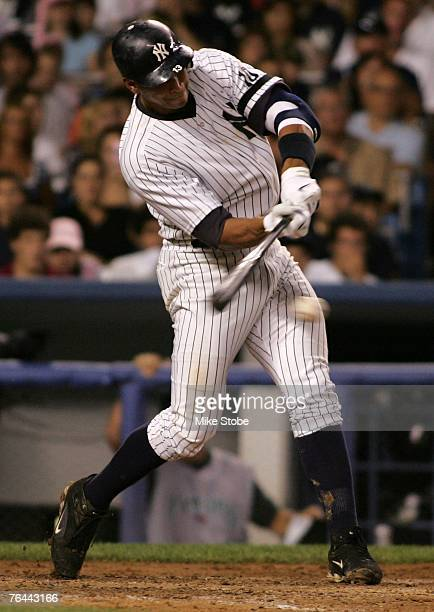 Alex Rodriguez of the New York Yankees hits an RBI single scoring Derek Jeter in the 4th inning against the Tampa Bay Devil Rays at Yankee Stadium on...