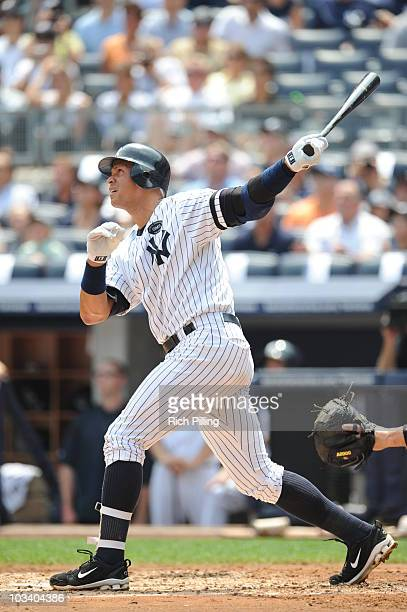 Alex Rodriguez of the New York Yankees hits career home run during the game against the Toronto Blue Jays at Yankee Stadium in the Bronx New York on...