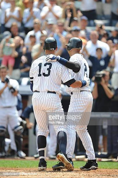 Alex Rodriguez of the New York Yankees is congratulated by Derek Jeter after hitting career home run during the game against the Toronto Blue Jays at...