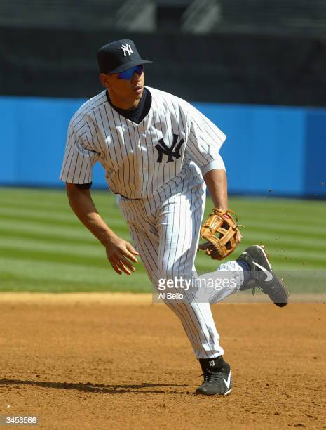 Alex Rodriguez of the New York Yankees jumps into action to field a play during the game against the Chicago White Sox on April 10 2004 at Yankee...