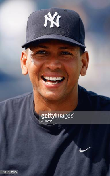 Alex Rodriguez of the New York Yankees laughs during an interview prior to the start of the Grapefruit League Spring Training game against the...