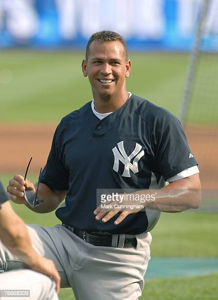 Alex Rodriguez of the New York Yankees looks on and smiles during pregame against the Detroit Tigers at Comerica Park in Detroit Michigan on August...
