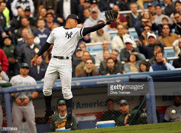 Alex Rodriguez of the New York Yankees misses a popup foul ball in the first inning against the Tampa Bay Devil Rays during their Opening Day game at...