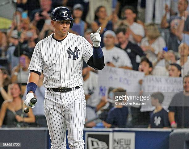 Alex Rodriguez of the New York Yankees motions towards the dugout of the Tampa Bay Rays as he comes to bat in the bottom of the first inning on...