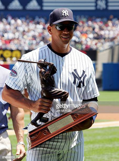 Alex Rodriguez of the New York Yankees poses with the 2007 Babe Ruth Home Run Award prior to the game against the Cincinnati Reds on June 21 2008 at...