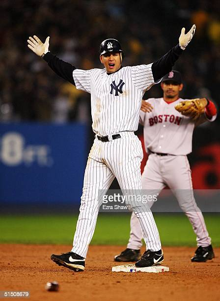 Alex Rodriguez of the New York Yankees reacts after being called out on a tag at first base by Pitcher Bronson Arroyo the Boston Red Sox as a bottle...