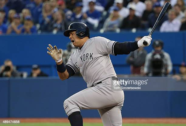 Alex Rodriguez of the New York Yankees reacts after fouling a ball off his ankle in the first inning during MLB game action against the Toronto Blue...