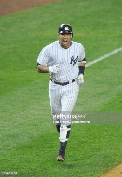Alex Rodriguez of the New York Yankees reacts after hitting a two run home run in the ninth inning off of Joe Nathan of the Minnesota Twins in Game...