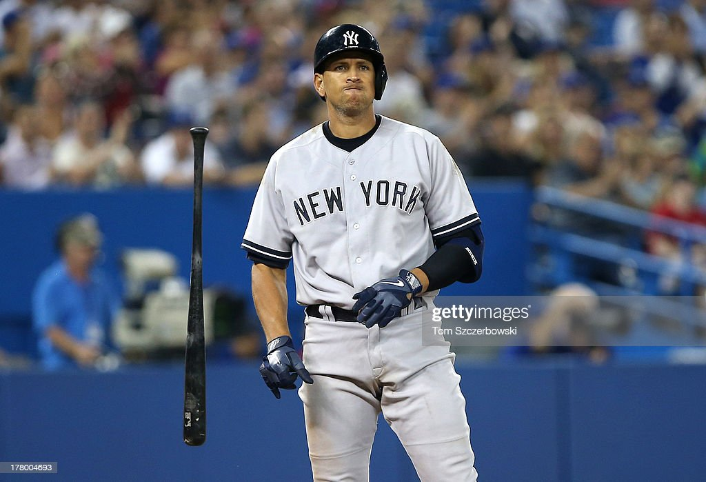 Alex Rodriguez #13 of the New York Yankees reacts after striking out in the eighth inning during MLB game action against the Toronto Blue Jays on August 26, 2013 at Rogers Centre in Toronto, Ontario, Canada.