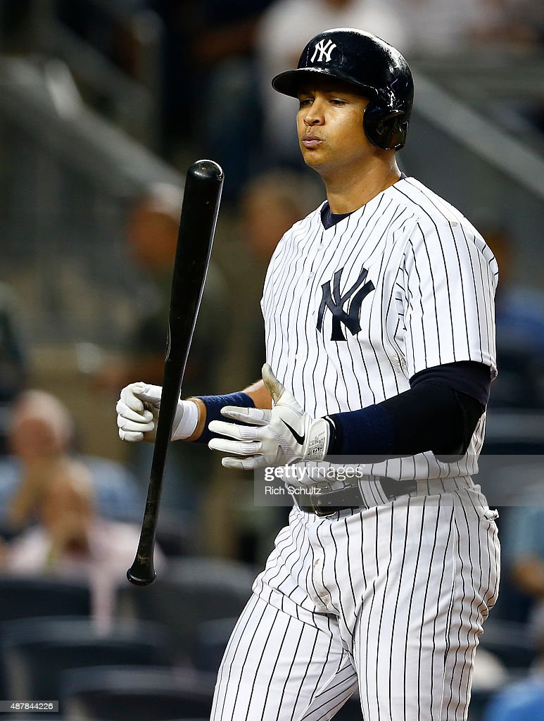 Alex Rodriguez #13 of the New York Yankees reacts after striking out in the seventh inning for the fourth time in the game against the Toronto Blue Jays at Yankee Stadium on September 11, 2015 in the Bronx borough of New York City. The Blue jays defeated the Yankees 11-5.