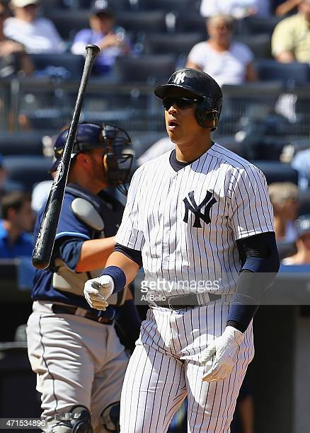 Alex Rodriguez of the New York Yankees reacts after striking out against the Tampa Bay Rays during their game at Yankee Stadium on April 29 2015 in...