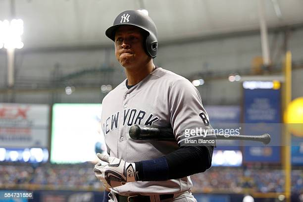 Alex Rodriguez of the New York Yankees reacts as he walks back to the dugout after striking out swinging to pitcher Drew Smyly of the Tampa Bay Rays...