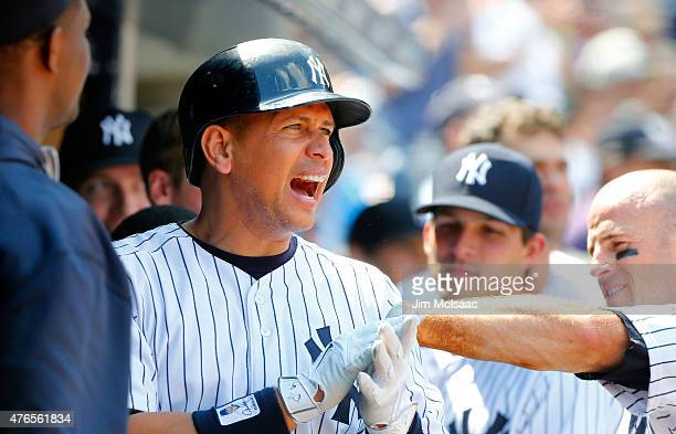 Alex Rodriguez of the New York Yankees reacts in the dugout after scoring a seventh inning run against the Washington Nationals at Yankee Stadium on...