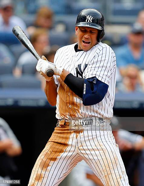 Alex Rodriguez of the New York Yankees reacts to an inside pitch during the fourth inning against the Chicago White Sox in a MLB baseball game at...