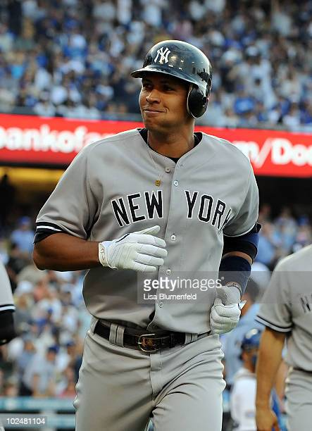 Alex Rodriguez of the New York Yankees returns to the dugout after hitting a two run homerun in the sixth inning against the Los Angeles Dodgers at...