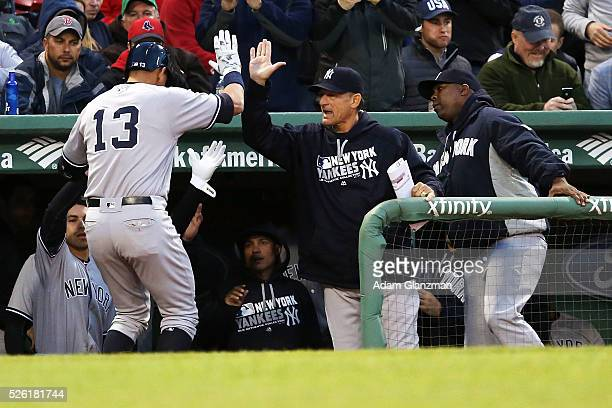 Alex Rodriguez of the New York Yankees returns to the dugout after hitting a home run in the second inning during the game against the Boston Red Sox...