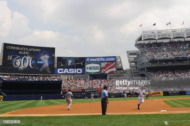 Alex Rodriguez of the New York Yankees rounds the bases after hitting the 600th home run of his career in the first inning against the Toronto Blue...