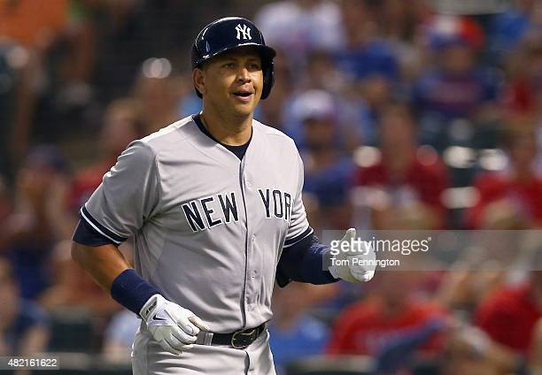 Alex Rodriguez of the New York Yankees rounds the bases after hitting a solo home run against the Texas Rangers in the top of the sixth inning at...