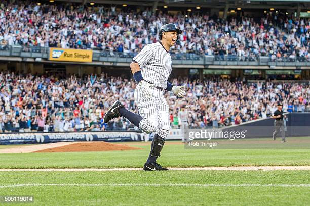 Alex Rodriguez of the New York Yankees rounds the bases after hitting a home run for his 3000th career hit in the first inning against Justin...