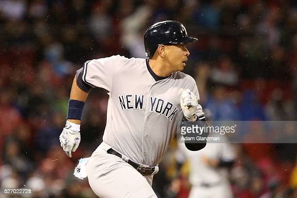 Alex Rodriguez of the New York Yankees rounds the bases after hitting a tworun home run in the third inning during the game against the Boston Red...