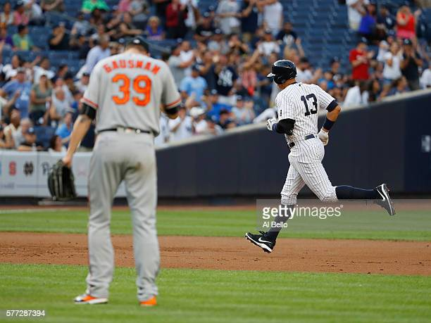 Alex Rodriguez of the New York Yankees rounds the bases after hitting a home run against Kevin Gausman of the Baltimore Orioles in the second inning...