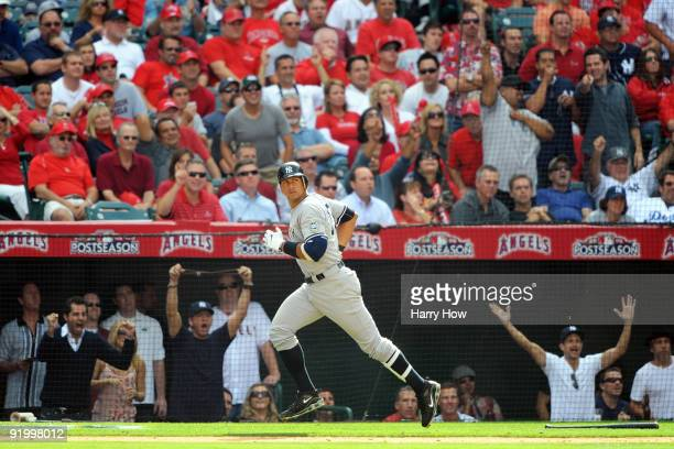 Alex Rodriguez of the New York Yankees rounds the bases after hitting a home run during the forth inning off Jered Weaver of the Los Angeles Angels...