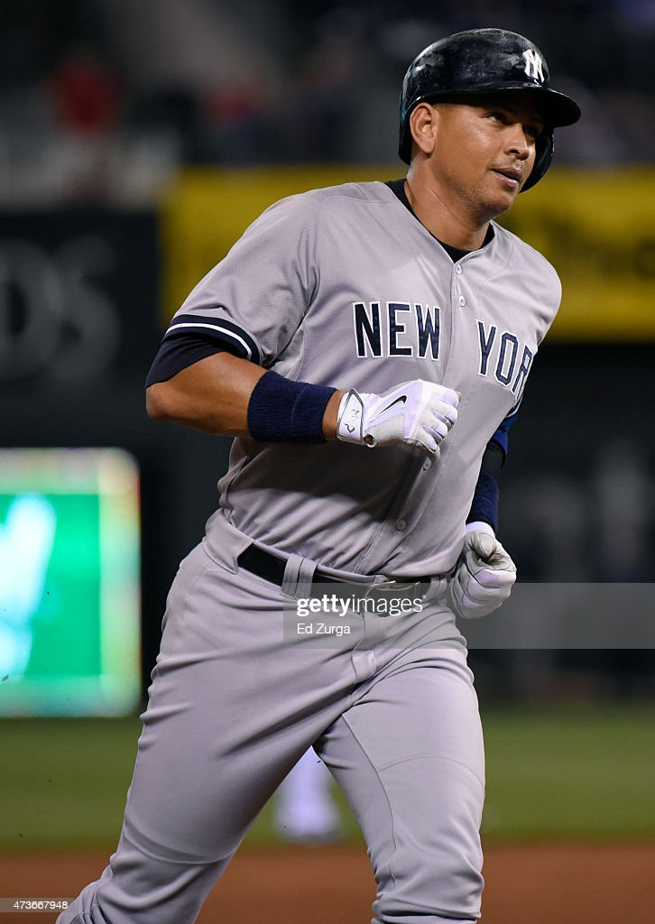 Alex Rodriguez #13 of the New York Yankees rounds third as he heads home after hitting a home run in the ninth inning against the Kansas City Royals at Kauffman Stadium on May 16, 2014 in Kansas City, Missouri.