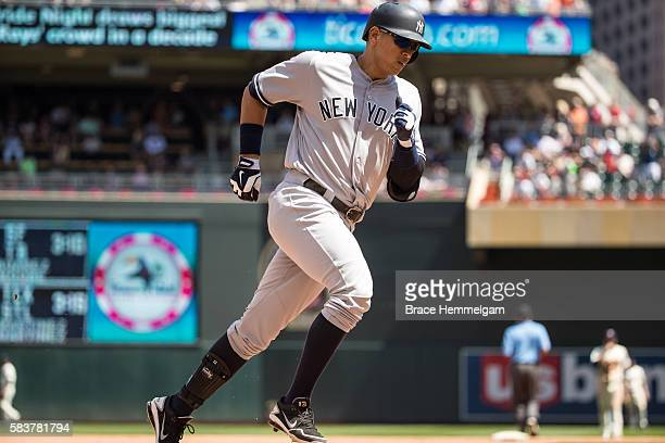 Alex Rodriguez of the New York Yankees runs after hitting a home run against the Minnesota Twins on June 18 2016 at Target Field in Minneapolis...