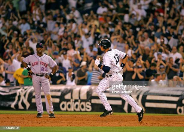 Alex Rodriguez of the New York Yankees runs the bases in front of Julio Franco of the New York Mets following his 3 run home run in the 5th inning at...