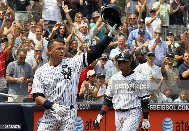 Alex Rodriguez of the New York Yankees salutes the crowd after hitting his 600th career home run in the first inning against the Toronto Blue Jays as...
