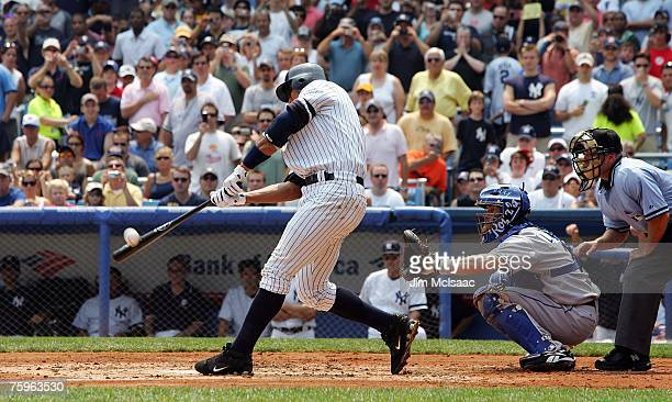 Alex Rodriguez of the New York Yankees sends the ball into the left field seats for his 500th career home run in the first inning against Kyle Davies...