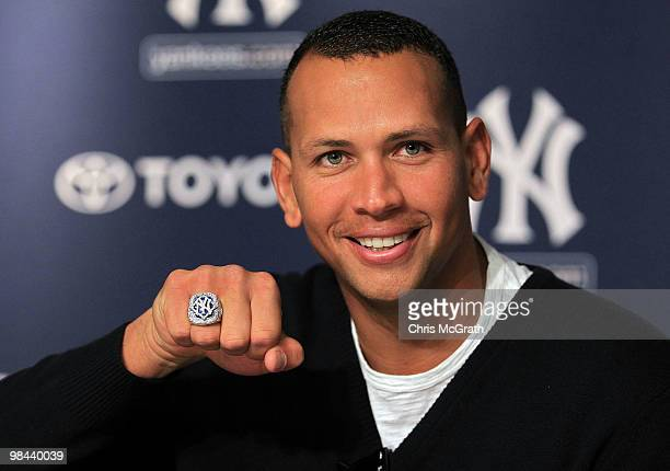 Alex Rodriguez of the New York Yankees shows off his World Series ring to the media during a press conference after the Yankees home opener at Yankee...