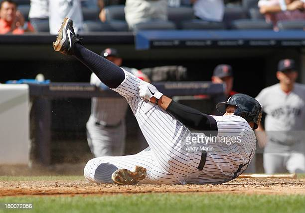 Alex Rodriguez of the New York Yankees slides home safely on a double by Mark Reynolds against the Boston Red Sox at Yankee Stadium on September 8...