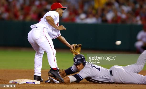 Alex Rodriguez of the New York Yankees slides safety into second base beneath tag of Orlando Cabrera of the Los Angeles Angels of Anaheim during 53...