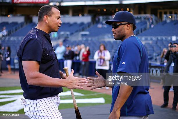Alex Rodriguez of the New York Yankees speaks with Robinson Cano of the Seattle Mariners prior to their game on Jackie Robinson Day at Yankee Stadium...