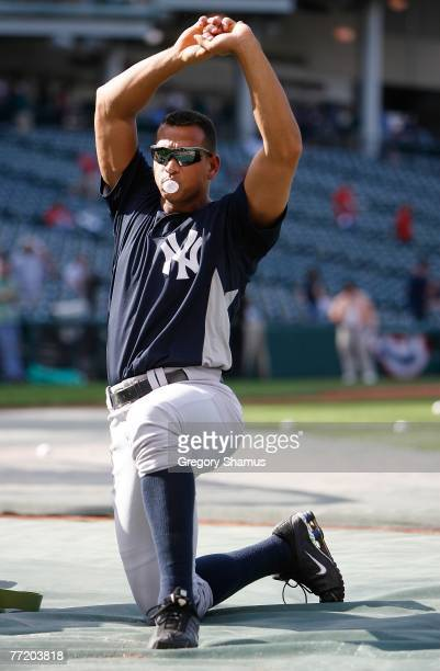 Alex Rodriguez of the New York Yankees stretches during batting practice against the Cleveland Indians during Game Two of the American League...